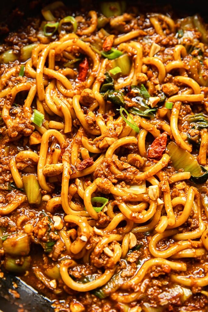Close up of noodles mixed together with other ingredients