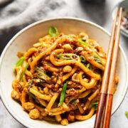Vegan dan dan noodles in white bowl