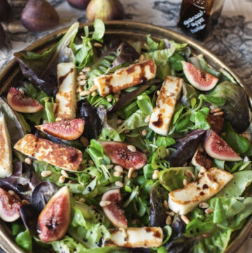 Platter with salad made of greens, halloumi and fresh figs