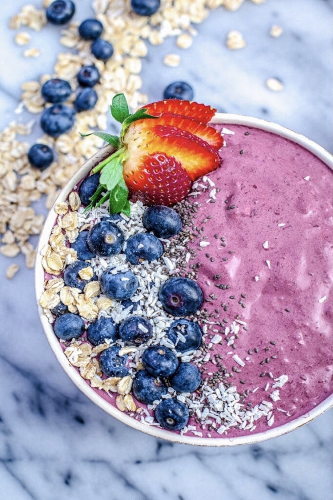 Close up of berry smoothie bowl with a strawberry on top