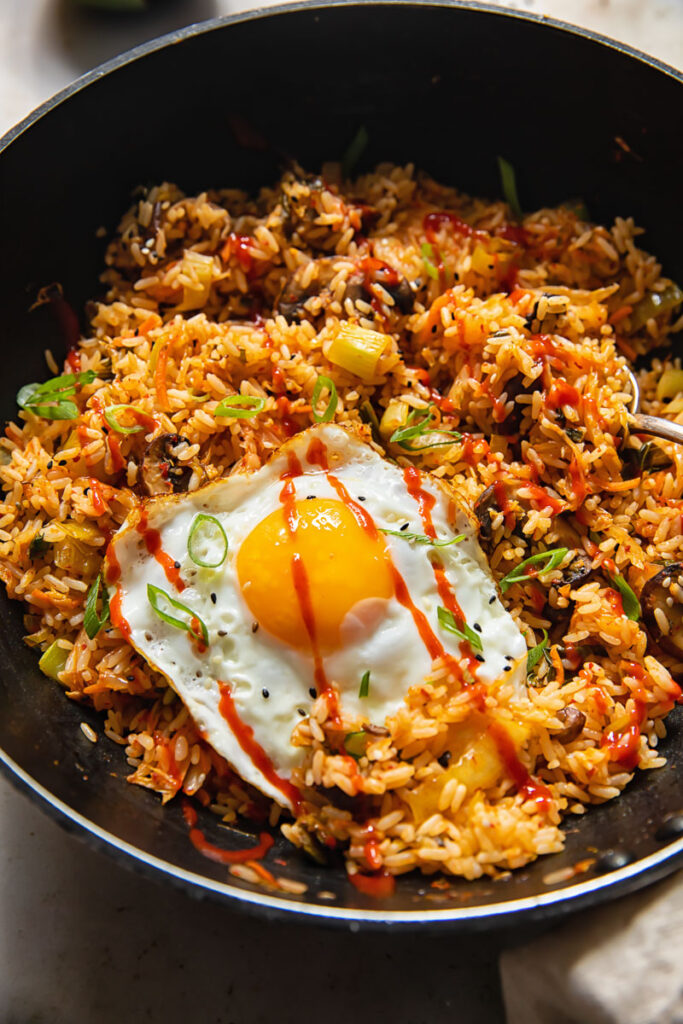 Wok with kimchi fried rice and a fried egg