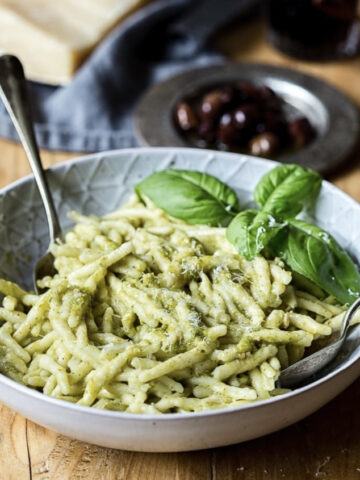 Close up view of pasta with additional basil leaf