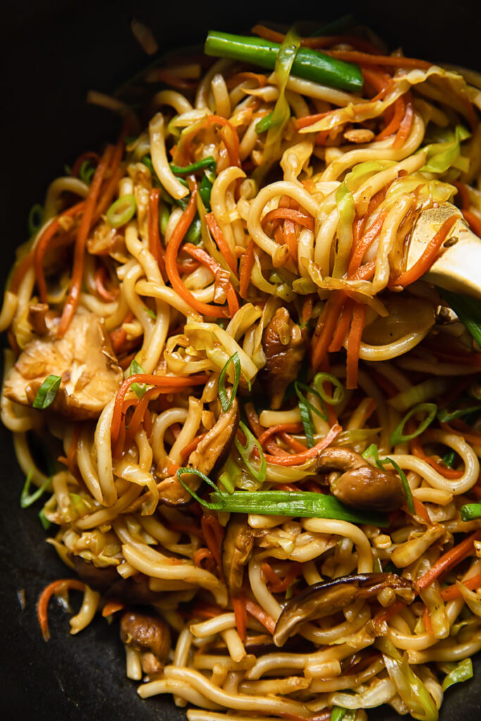 Close up view of vegetarian yaki udon stirred in a pan