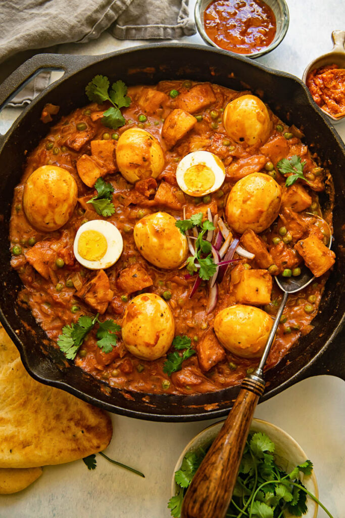 Egg curry in a cast iron frying pan
