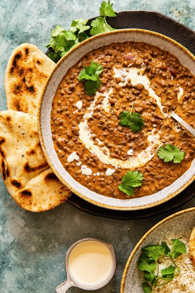 Dal makhani in a bowl with naan