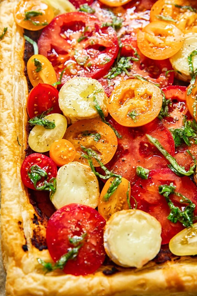 Close up of the tart showing tomatoes and basil
